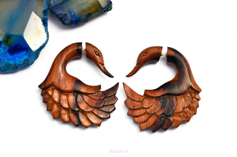 blue and black swan wooden gauge earrings