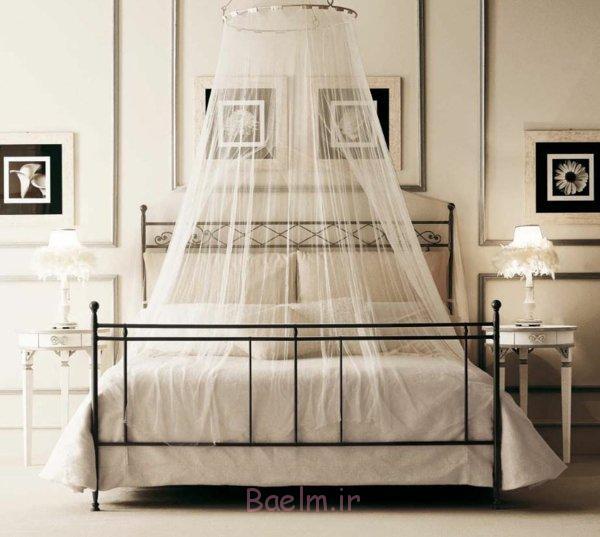schlafzimmer gestalten metallbett klassisch schmiedeeisen baldachin wanddekoration fotos