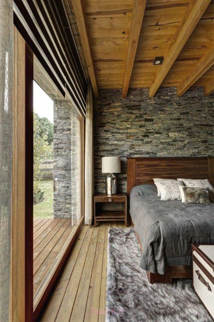 schlafzimmergestaltung rustikale innneneinrichtung holz bettgestell steinwand