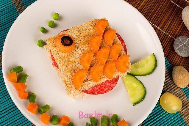 به شکل ماهی با توت فرنگی با خیار و زیتون سفره آرایی, تزیین غذاهای مختلف, تزیین غذاهای مجلسی
