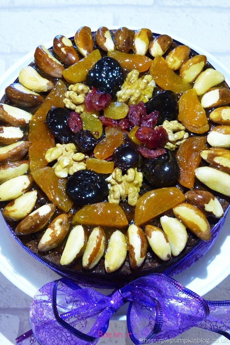 decorating-a-christmas-cake-with-dried-fruit-and-nuts-2