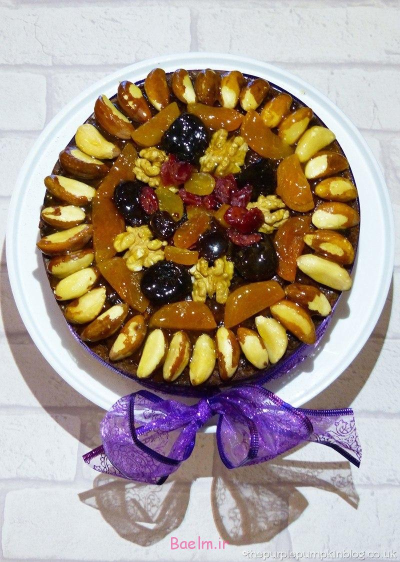 decorating-a-christmas-cake-with-dried-fruit-and-nuts-3